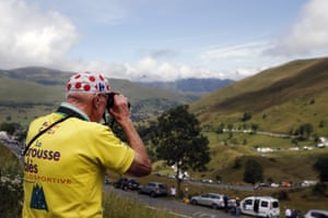 Stage 12 Toulouse - Bagneres-de-Bigorre, 209.5km A fan scours the valley for the peloton