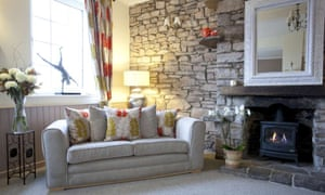 Cosy sofa and woodburner in Ty Croeso, Wales.