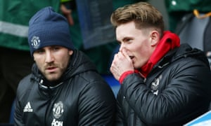 Luke Shaw, left, pictured on the substitutes bench during the FA Cup match at Blackburn Rovers.