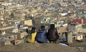 Afghan boys look over the city of Kabul, Afghanistan.