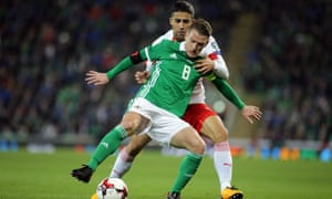 Steven Davis feels the close attentions of Switzerland's Ricardo Rodriguez in the World Cup playoff first leg.