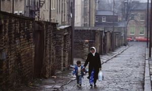 A Muslim woman and child in Bradford: the poll found Muslim and black Caribbean people were more discriminated against than those of Jewish, white and Chinese backgrounds.