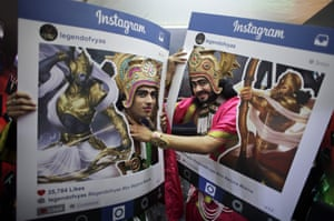 Fans dressed as Hindu mythological characters pose for photographs at Delhi Comic Con