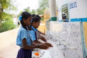 Pupils at a waterpoint at a girls primary school in Kavithal village, Karnataka, India