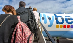 Passengers board BA plane.