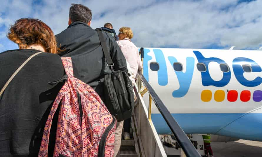 Passengers boarding an Embraer E175 jet operated by Flybe