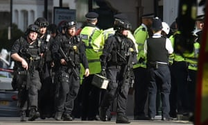 Armed police near Parsons Green station in west London after the explosion.