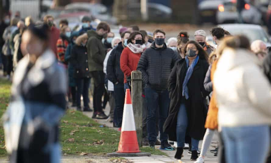 People queue for tests at the city's Wavertree Sports Park.
