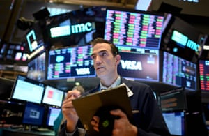 Traders at work during the closing bell at the New York Stock Exchange on 18 March.