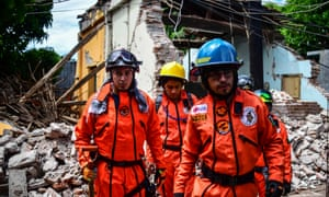 Rescuers search crumbled houses in Juchitán, Oaxaca.