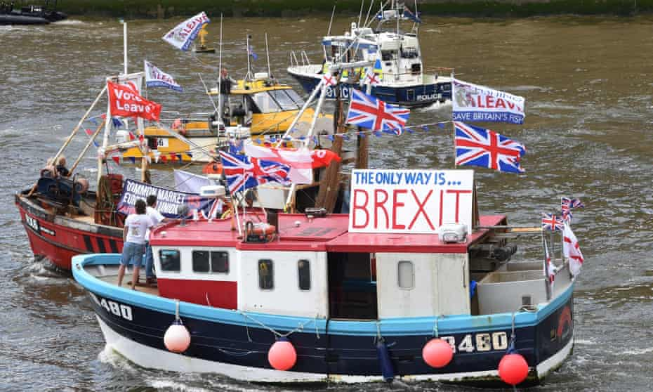 A flotilla of fishing trawlers, organised by Nigel Farage, sailing up the river Thames during the referendum campaign.