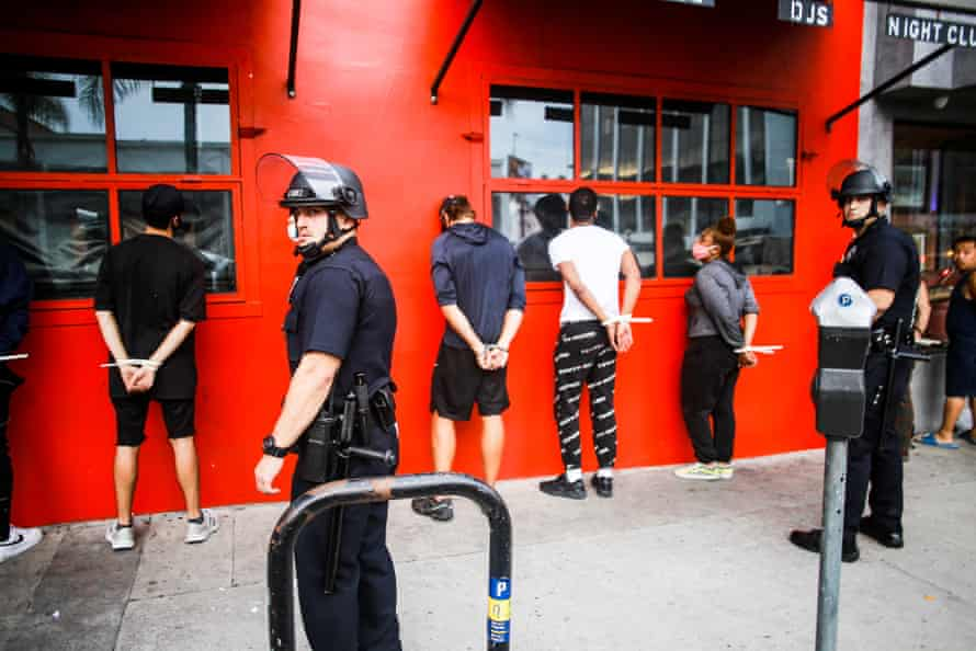 Police detain people during the George Floyd protests in Los Angeles on 1 June 2020.