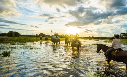 People riding horses in the Pantanal, Brazil