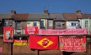 Peter Carney shows off a collection of his banners in Liverpool. Photo by Jack Finnigan.