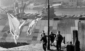Children playing in a street near shipyards, 1954.