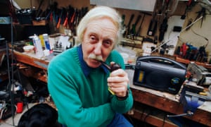 Trevor Bayliss smoking a pipe in his workshop at his home on Eel Pie Island on the Thames, with the wind-up radio he invented
