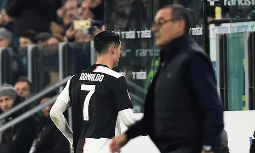 Cristiano Ronaldo walks past Maurizio Sarri and straight down the tunnel