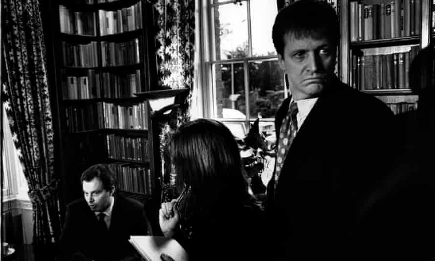Alastair Campbell, press secretary to Labour leader Tony Blair, fends off the political hacks as Tony Blair gives an interview, 1998