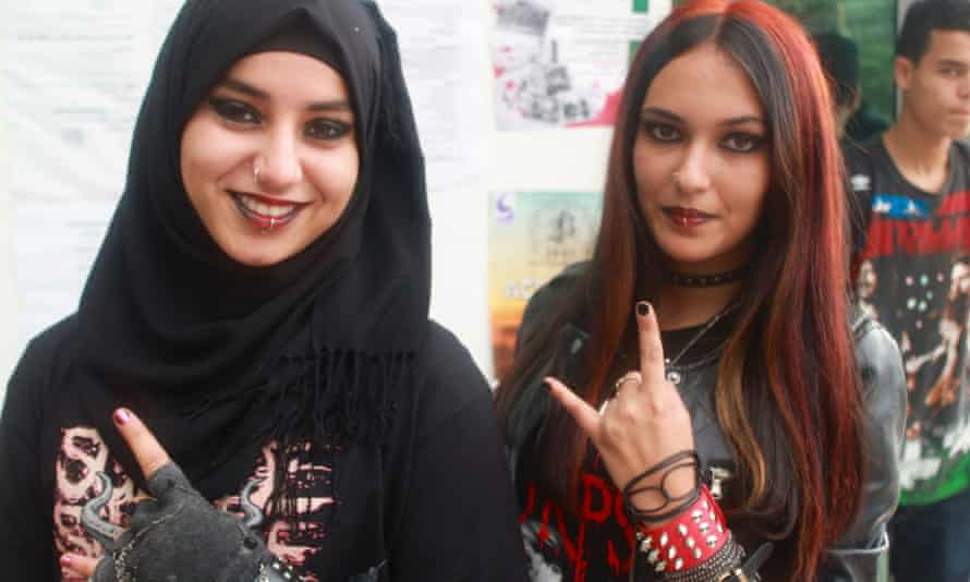 Metal fan Sadness Spirit, right, and friend at Fest 213 in Constantine, Algeria.