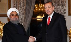 Turkey's President Recep Tayyip Erdogan (right) meets Iran's President Hassan Rouhani