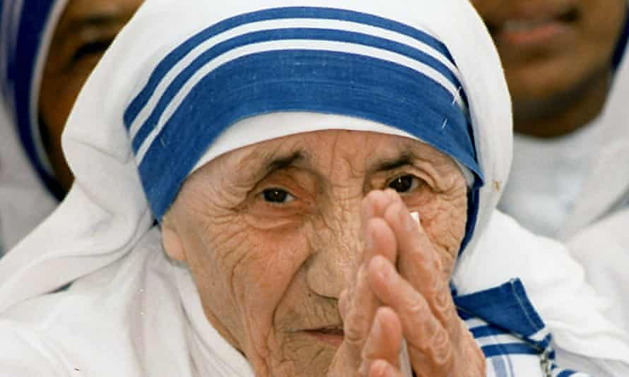 Mother Teresa greeting people at the Missionaries of Charity For Destitute Children in New Delhi in 1997.