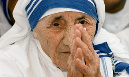 Mother Teresa greets people at the Missionaries of Charity for destitute children in Delhi in 1997.
