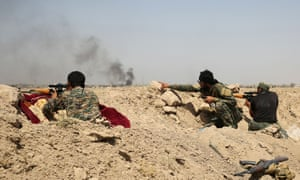 Iraqi government forces in Saqlawiyah, north-west of Falluja, fight to regain control of the area from Isis.