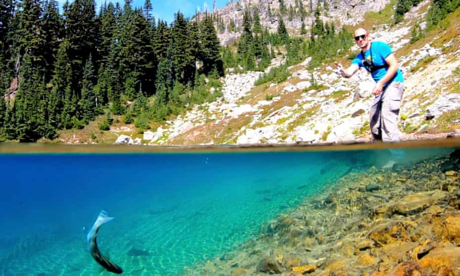 Fishing in a clear lake for trout in Washington State, US