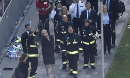 Theresa May speaks to Dany Cotton and firefighters at Grenfell Tower on Thursday.