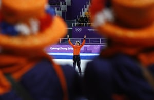 Esmee Visser of The Netherlands celebrates her gold on the podium after the women's 5,000 meters speedskating race.