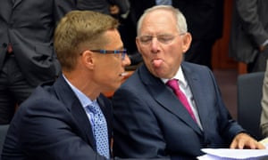 The German finance minister, Wolfgang Schäuble, sticks his tongue out at his Finnish counterpart, Alexander Stubb