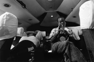 Louis Armstrong practicing on a plane ride from Nigeria to the Gold Coast, 1956