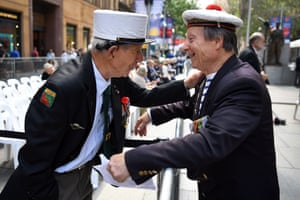 Two French veterans chat before a Remembrance Day service at the Cenotaph in Sydney's Martin Place