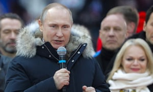 Vladimir Putin addresses a rally in his support at the Luzhniki Stadium ahead of the 2018 Russian presidential election scheduled for March 18.