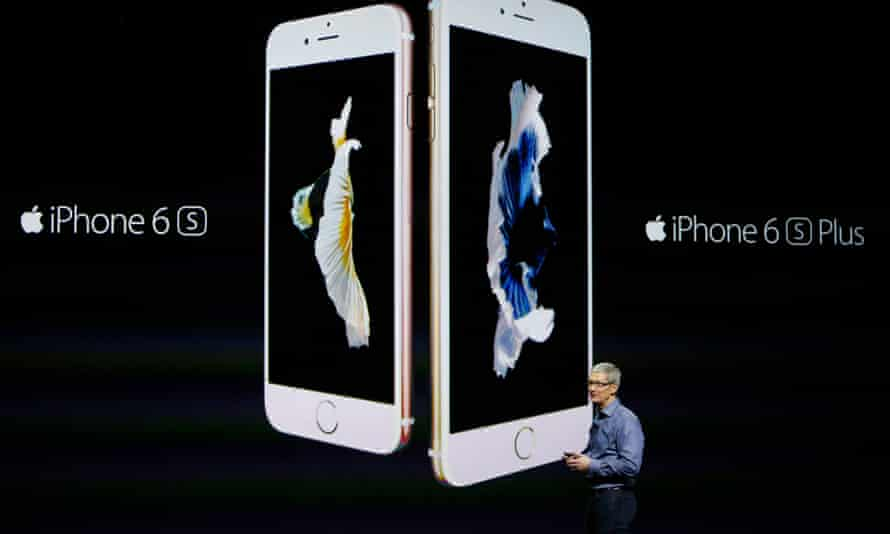 Apple CEO Tim Cook talks about the new iPhones at an event in California