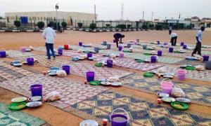 Volunteers prepare food aid for families in Khartoum's suburbs.