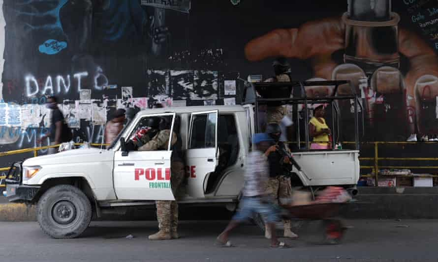Haitian police standing guard in Port-au-Prince on Monday as protests were planned after the assassination of President Jovenel Moïse.