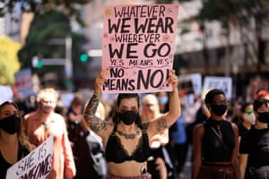 A women holds a sign during the Sydney protest