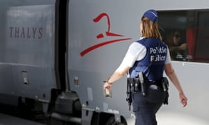 A Belgian police officer patrols at the Thalys train terminal in Brussels, where the gunman boarded the train