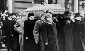 Secret police head Lavrenti Beria (far right) carries Stalin's coffin.