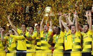 Borussia Dortmund players, including Ousmane Dembélé (right of centre) celebrate their win over Eintracht Frankfurt in the 2016-17 DFB-Pokal final.