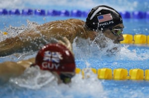 United States' Michael Phelps and Britain's James Guy compete in the men's 4 x 100m medley relay final