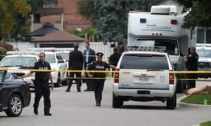 Police attend the scene in the Scarborough suburb of Toronto following the crossbow deaths of three people.