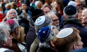 Men wear kippahs outside a Jewish community centre in Berlin