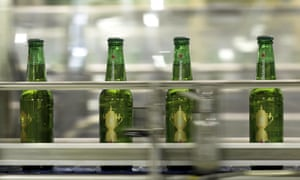 Bottles of Heineken, featuring labels with the Webb Ellis Cup logo, on the production line in Yokohama.