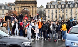 High school students block a road during a demonstration against education reforms in Bordeaux.