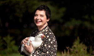 Actress, model and filmmaker Isabella Rossellini holds one of her heritage chickens on her Mama Farm in Brookhaven, New York.