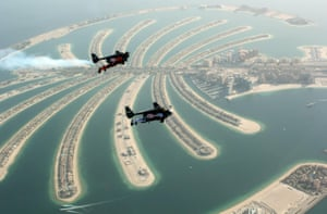 Dubai, United Arab Emirates Swiss pilot and original Jetman Yves Rossy and Vince Reffett flying over Palm Island