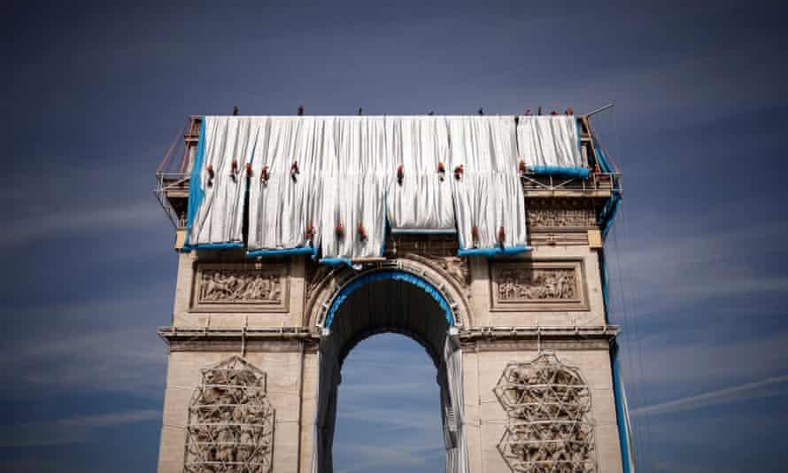 Abseilers begin to wrap the Arc de Triomphe monument in Paris