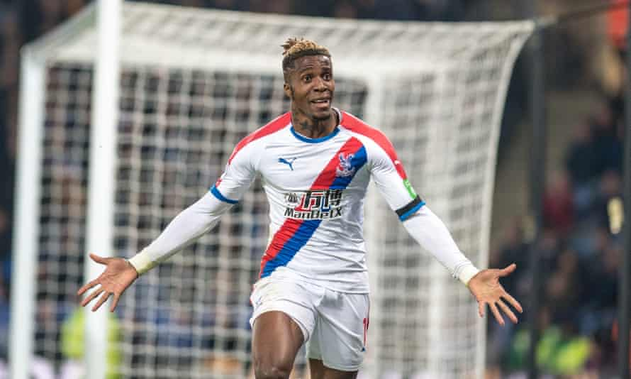 Wilfried Zaha celebrates after scoring goal Crystal Palace's second goal against Leicester.